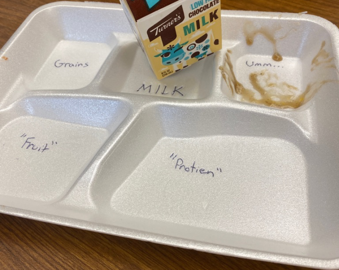 typical school lunch styrofoam tray with milk carton and straw